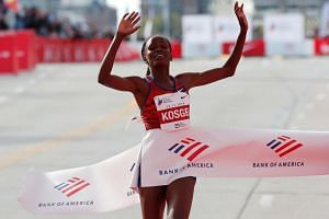 Kenyan Brigid Kosgei set a blistering pace from the start to shatter the previous record of 2:15:25 which Briton Radcliffe set in 2003.