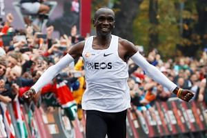 Kenya's Eliud Kipchoge, the marathon world record holder, celebrates as he successfully completes his attempt to run a marathon in under two hours in Vienna, Austria on Oct 12, 2019.