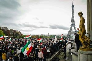 People take part in a demonstration at the Human Rights plaza in Paris on Oct 12, 2019, to support Kurdish militants as Turkey kept up its assault on Kurdish-held border towns in north-eastern Syria today, on the fourth day of an offensive that is dr