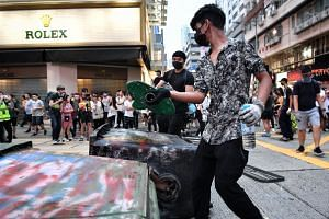 Protesters set up a makeshift roadblock with rubbish bins in Mong Kok, Hong Kong, on Oct 13, 2019.