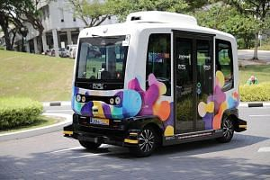 A driverless shuttle operating in NUS, on July 29, 2019. The service, which is free of charge, will not operate when it rains.ST PHOTO: GIN TAY