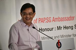 Deputy Prime Minister Heng Swee Keat speaking at an event by the People's Action Party Seniors Group to mark the International Day of Older Persons on Oct 13, 2019.