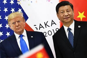 Chinese President Xi Jinping (right) and US President Donald Trump attending a bilateral meeting on the sidelines of the G20 Summit in Osaka, Japan, on June 29, 2019.