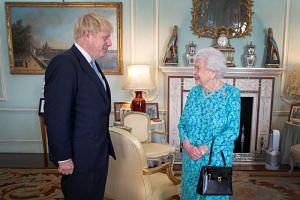 In this picture taken on July 24, 2019, Queen Elizabeth II welcomes Boris Johnson during an audience in Buckingham Palace.