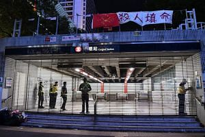 MTR staff closed the shutters of Central Station at 10pm sharp, on Oct 14, 2019.