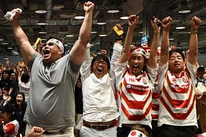Fans of the Japanese team celebrate during the Japan 2019 Rugby World Cup Pool A match between Japan and Scotland in Yokohama on Oct 13, 2019.