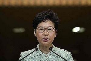 Hong Kong leader Carrie Lam is under pressure to regain trust and quell unrest that has plunged the city into a political crisis. PHOTO: AGENCE FRANCE-PRESSE