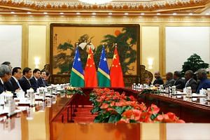 A photo taken on Oct 9 shows Solomon Islands Prime Minister Manasseh Sogavare during a meeting with Chinese Premier Li Keqiang at the Great Hall of the People in Beijing.