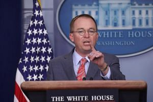 Acting White House Chief of Staff Mick Mulvaney takes questions during a news briefing at the White House in Washington, October 17, 2019.