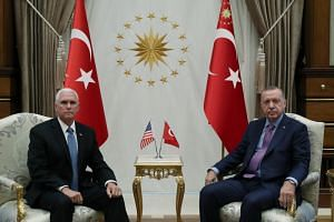 US Vice-President Mike Pence (left) and Turkish President Tayyip Erdogan meet at the Presidential Palace in Ankara, Turkey on Oct 17, 2019.