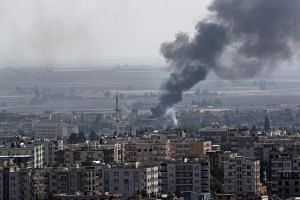 Smoke rises from targets inside Syria during bombardment by Turkish forces at Ras Al-Ein town, on Oct 17, 2019.