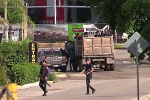 Images carried on Mexican television showed army and police forces under assault by civilians armed with heavy machine guns.