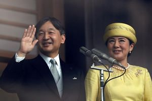 In a photo taken on May 4, 2019, Japan's Emperor Naruhito and Empress Masako greet well-wishers during their first public appearance at the Imperial Palace in Tokyo, Japan.