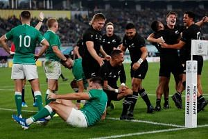 New Zealand's scrum-half Aaron Smith celebrating one of his two tries against Ireland in their Rugby World Cup quarter-final at the Tokyo Stadium in Tokyo on Oct 19, 2019.