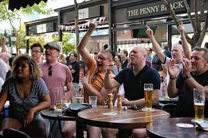 Fans cheering at The Penny Black pub as England score a try during their quarter-final victory over Australia.