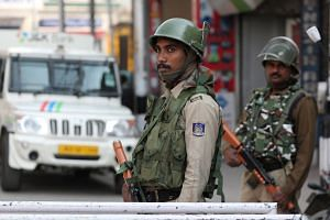 Indian paramilitary soldiers standing guard in Srinagar, Kashmir, on Oct 17, 2019.