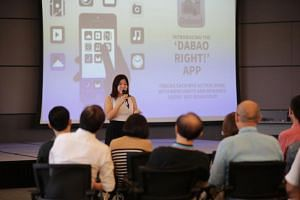Marketing manager Lee Peilin presenting her team's Dabao Right mobile app during a workgroup on