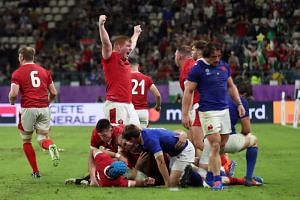 Wales players celebrate after their 20-19 victory over France in the Rugby World Cup quarter-finals at Oita Stadium in Japan on Oct 20, 2019.