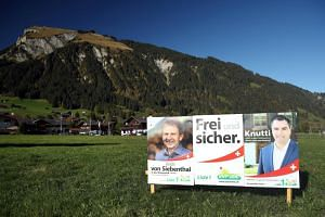 A photo taken on Oct 14 shows election posters of the Swiss People's Party candidates in Lenk, Switzerland.