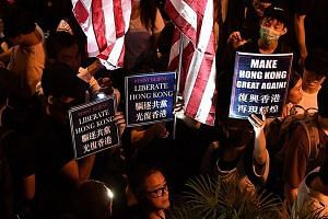Pro-democracy protesters at Chater Garden in Hong Kong last week. The writer says the current impasse between the protesters and the Hong Kong government is a direct consequence of inaction by past governments in satisfying basic housing needs, provi
