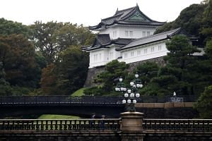 Guards patrol outside the Imperial Palace on the day Emperor Naruhito is formally enthroned in Tokyo, Japan on Oct 22, 2019.