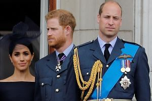 """Meghan Markle, Prince Harry and Prince William, at Buckingham Palace in July last year. The BBC quoted a palace source on Monday as saying there was a view that the couple were """"in a fragile place""""."""