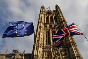 British lawmakers on Tuesday voted narrowly in favour of legislation for a Brexit deal that Prime Minister Boris Johnson clinched with the EU last week, but minutes later voted against his tight timetable for parliamentary approval.