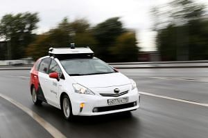 A self-driving car drives along a road during a presentation in Moscow, Russia, on Aug 16, 2019. Industry observers reckon that driverless cars will be rendered immobile in a mixed vehicle urban environment because they will not move unless it is abs