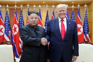 A photo taken on June 30 shows US President Donald Trump meeting North Korean leader Kim Jong Un in the demilitarised zone separating the two Koreas in Panmunjom.