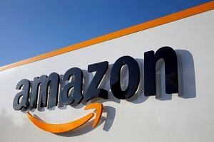The logo of Amazon is seen at the company logistics centre in Boves, France.