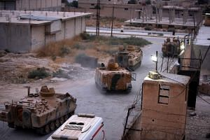 A photo taken on Oct 20, 2019 of armoured personnel carriers provided by Ankara in the Syrian border town of Tal Abyad. Under the peace plan, Syrian Kurdish forces are to withdraw more than 30 km from the Turkish border.