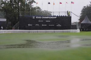 Rain falls on the practice green of the PGA Zozo Championship golf tournament at the Narashino Country Club in Inzai, Chiba prefecture, on Oct 25, 2019. The Zozo Championship is the first official-money PGA Tour event in Japan.
