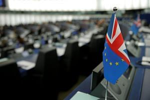 An hybrid flag depicting the European Union and the British flags is seen during a debate on the last EU summit and Brexit at the European Parliament in Strasbourg, France, on Oct 22, 2019.