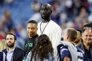 In a photo taken on Sept 8, 2019, Tacko Fall of the Boston Celtics attends the game between the New England Patriots and the Pittsburgh Steelers at Gillette Stadium in Foxborough, Massachusetts.