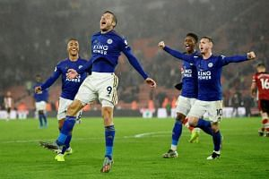 Leicester City's Jamie Vardy celebrates scoring their ninth goal from the penalty spot.