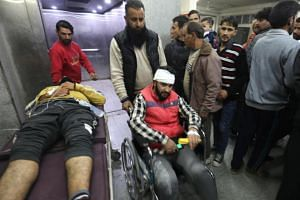 Two men who were injured in a grenade attack arrive at a hospital in Srinagar on Oct 28, 2019.
