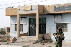 A photo taken on Oct 14 shows a former YPG office at the entrance of Tel Abyad, Syria.