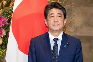 """Japanese Prime Minister Shinzo Abe has called on his ministers to """"be very careful with the way they speak and act""""."""