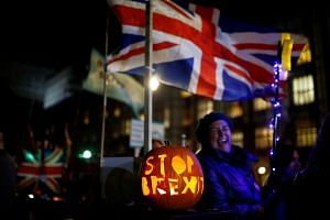 "A pumpkin with ""Stop Brexit"" engraved on it sits outside the Houses of Parliament in London."