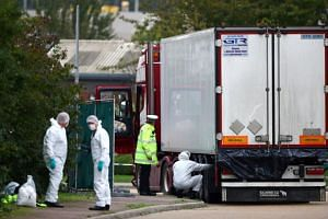 Police at the scene where bodies were discovered in a lorry container, in Grays, Essex, Britain, on Oct 23, 2019. The truck had arrived on a ferry from Belgium.