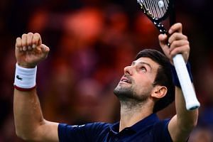 Djokovic celebrates after winning against Bulgaria's Grigor Dimitrov.
