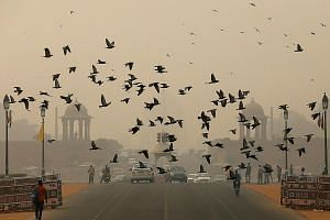 Smog covering the area near India's Presidential Palace in New Delhi on Friday, a day recorded as the most polluted in around two years. Besides vehicular and factory emissions, the toxic smog that hangs over Delhi, as well as its suburbs, is a mix o