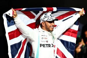 Formula One World Drivers Champion Lewis Hamilton of Great Britain and Mercedes GP celebrates in parc ferme during the F1 Grand Prix of USA at Circuit of The Americas on Nov 3, 2019 in Austin, Texas.