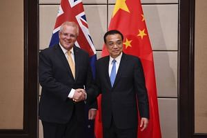 Australian Prime Minister Scott Morrison (left) meets Chinese Prime Minister Li Keqiang during their meeting on the sidelines of the ASEAN Summit on Nov 3, 2019.