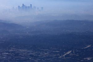 The buildings of downtown Los Angeles are partially obscured in California on Nov 5, 2019. The report ranked nearly 75 per cent, or 136, of the pledges as insufficient.