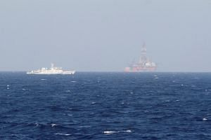 In a file photo taken on May 14, 2014, an oil rig (right) which China calls Haiyang Shiyou 981, and Vietnam refers to as Hai Duong 981, is seen in the South China Sea.