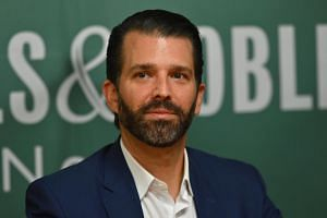In this photo taken on Nov 5, 2019, Donald Trump Jr. poses at Barnes & Noble in New York. He tweeted the name of a CIA analyst which has circulated online for weeks.