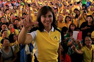In a photo taken in May 2016, then Philippine vice-presidential candidate Leni Robredo flashes a Laban (Fight) sign during her campaign rally in Quezon City.