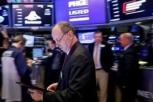 Traders work on the floor at the New York Stock Exchange, Nov 6, 2019.