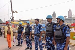 Security personnel stand guard on a street in Ayodhya on Nov 7, as part of a security measure ahead of a Supreme Court verdict on disputed 16th-century Babri mosque.